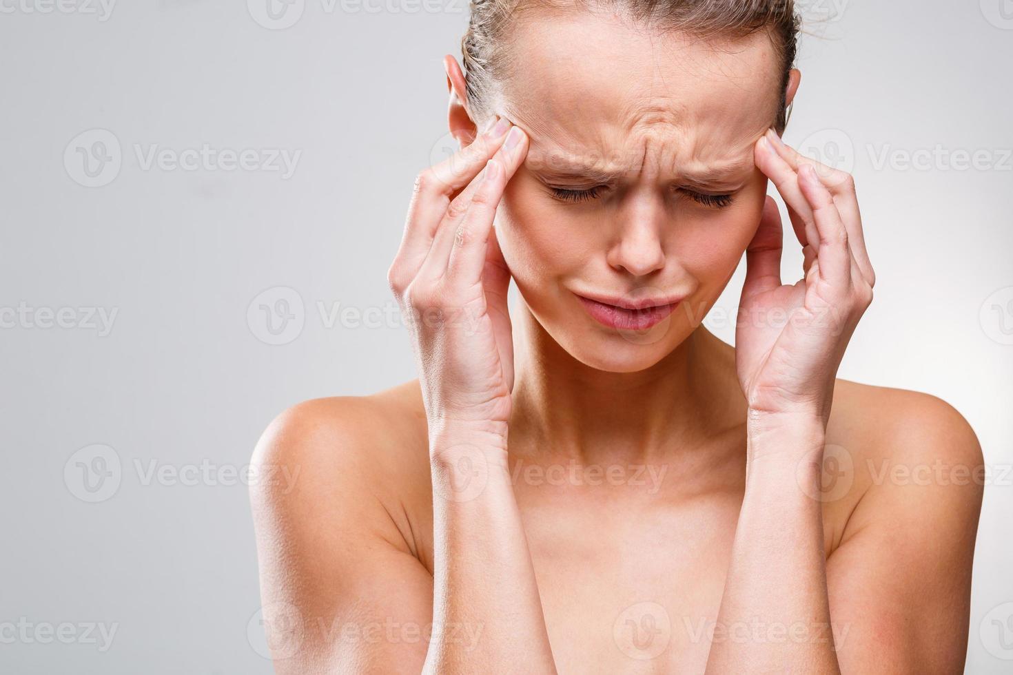 Beautiful woman suffering from acute headache photo