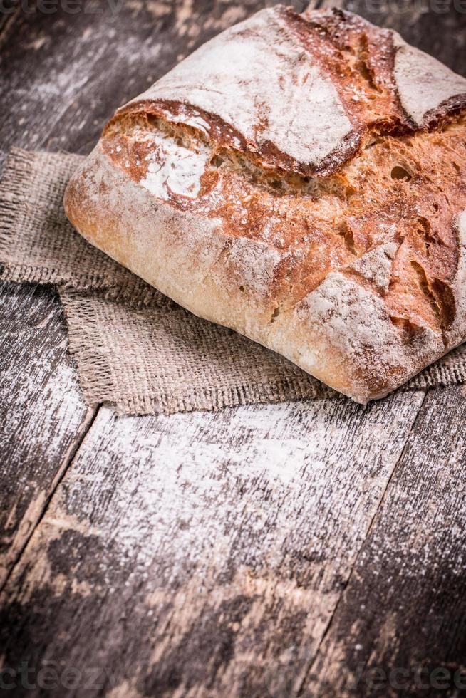 Fresh bread on wooden table photo
