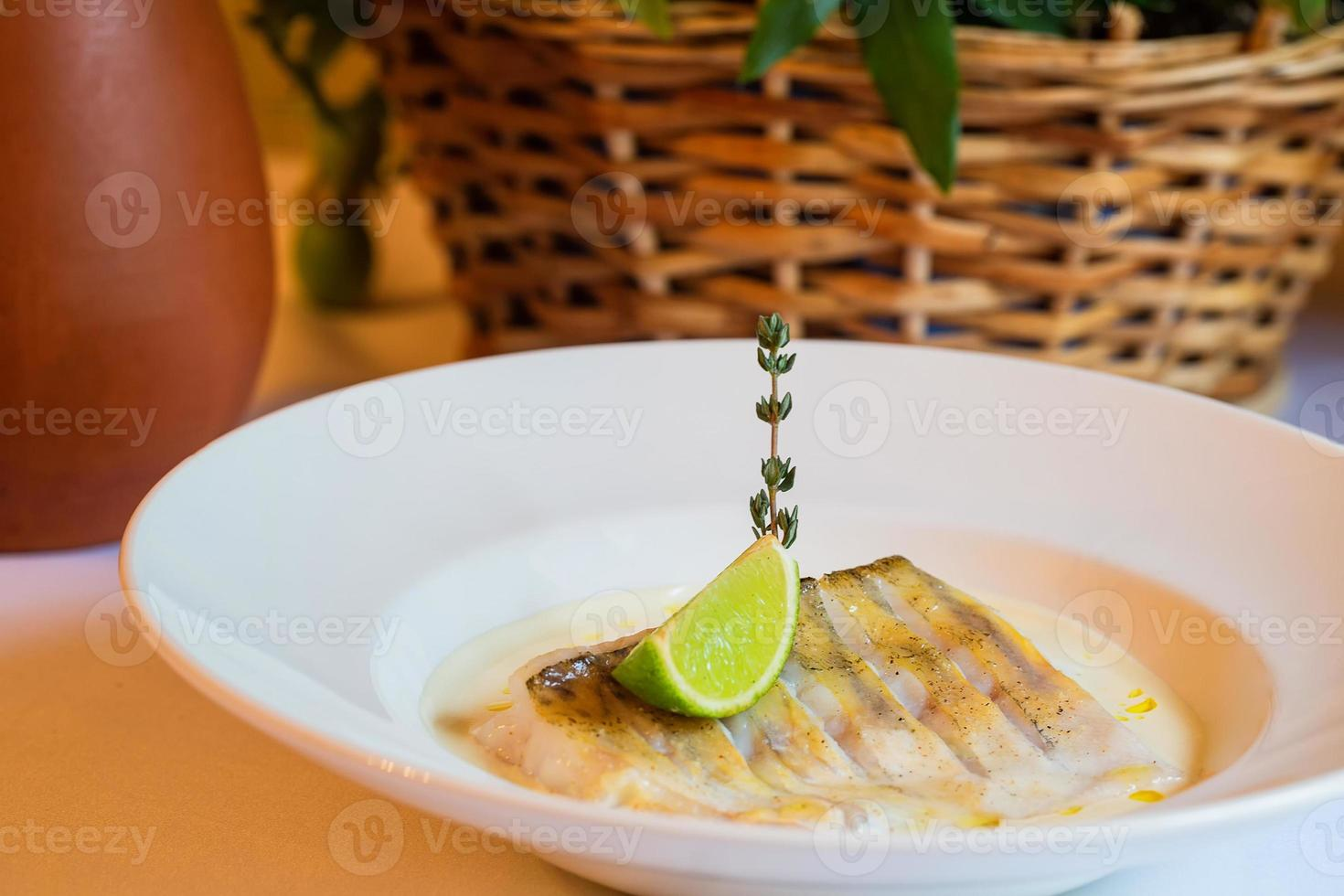Perch steamed in white sauce and lemon photo
