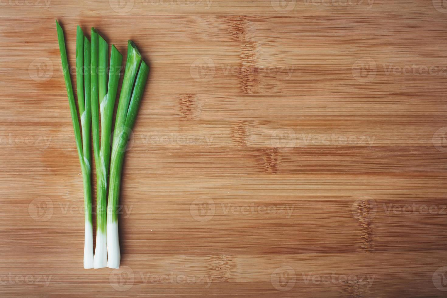 green onions on a wooden photo