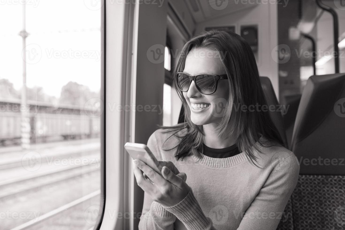 Young woman using smart phone photo