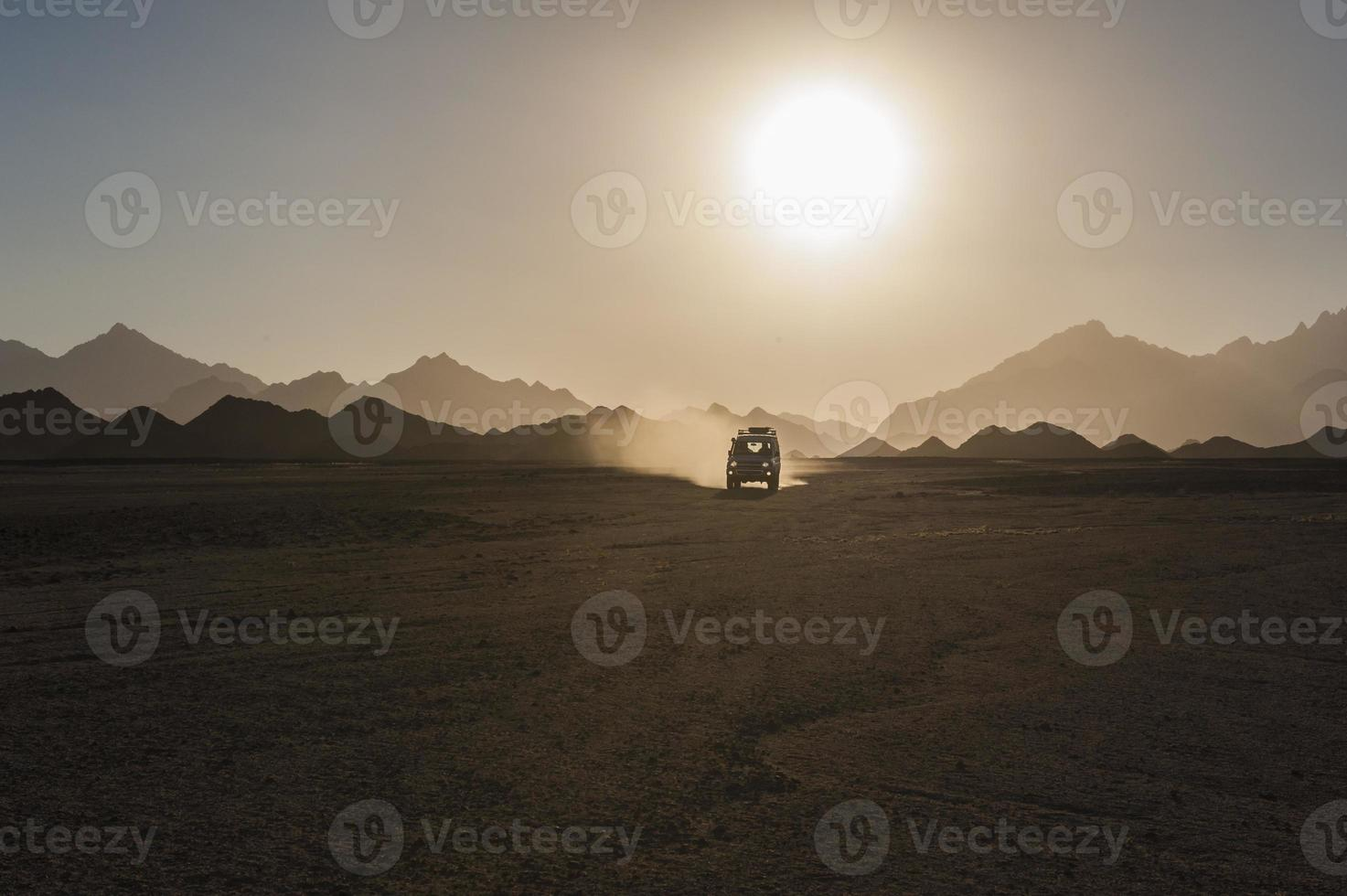 Off road safari in desert with sunset photo