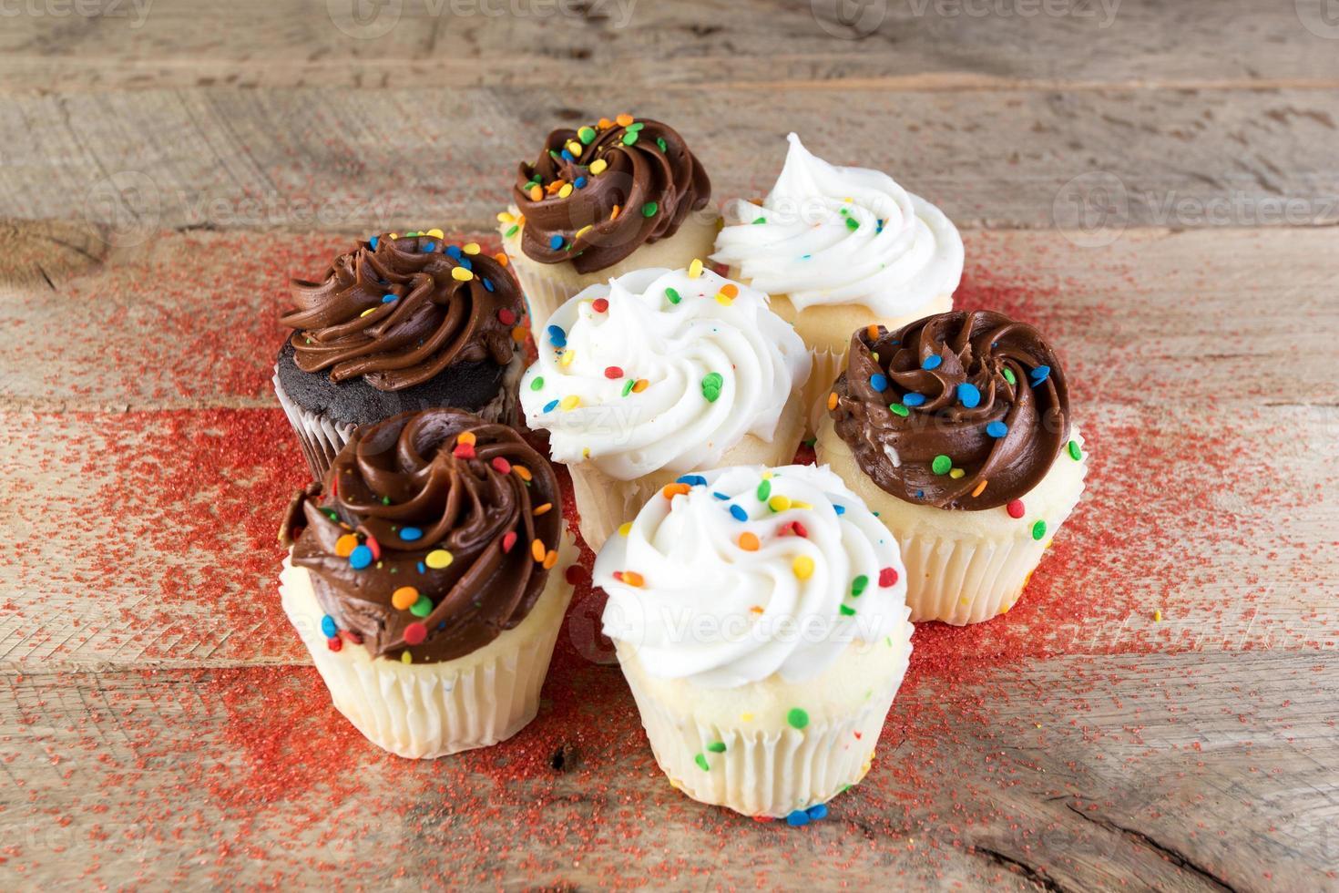 Homemade white and chocolate cupcakes. photo