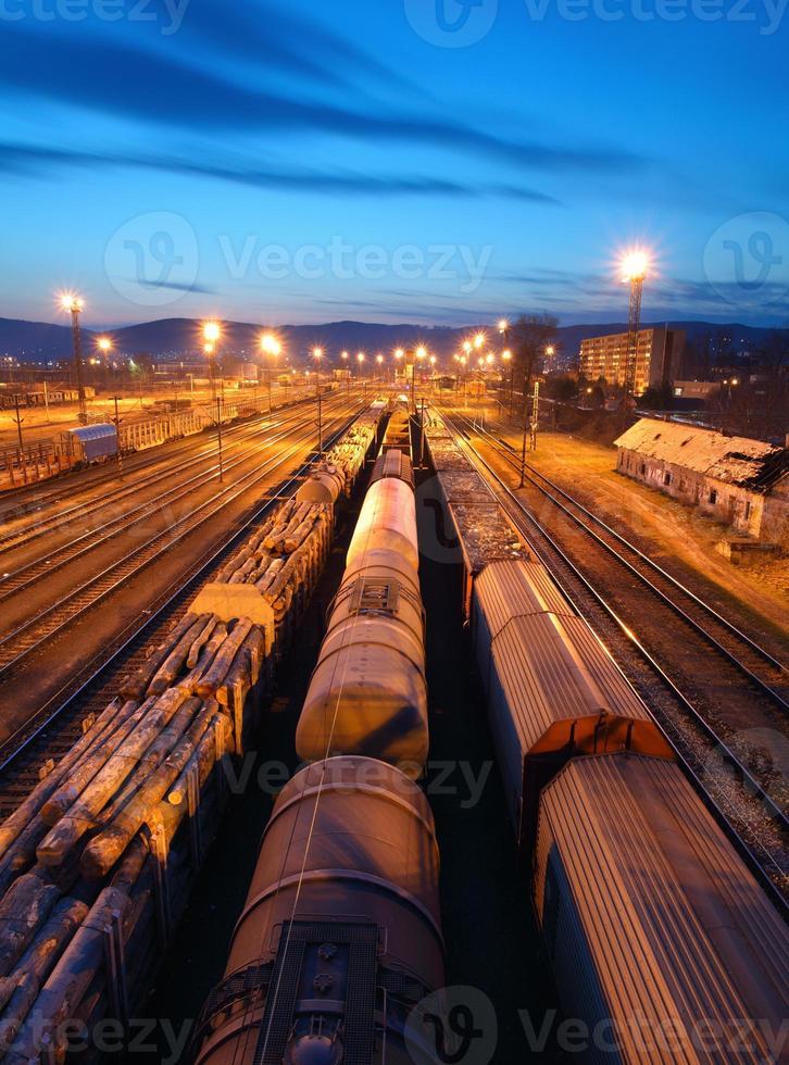 Freight Trains and Railways at dusk - Cargo transportation photo