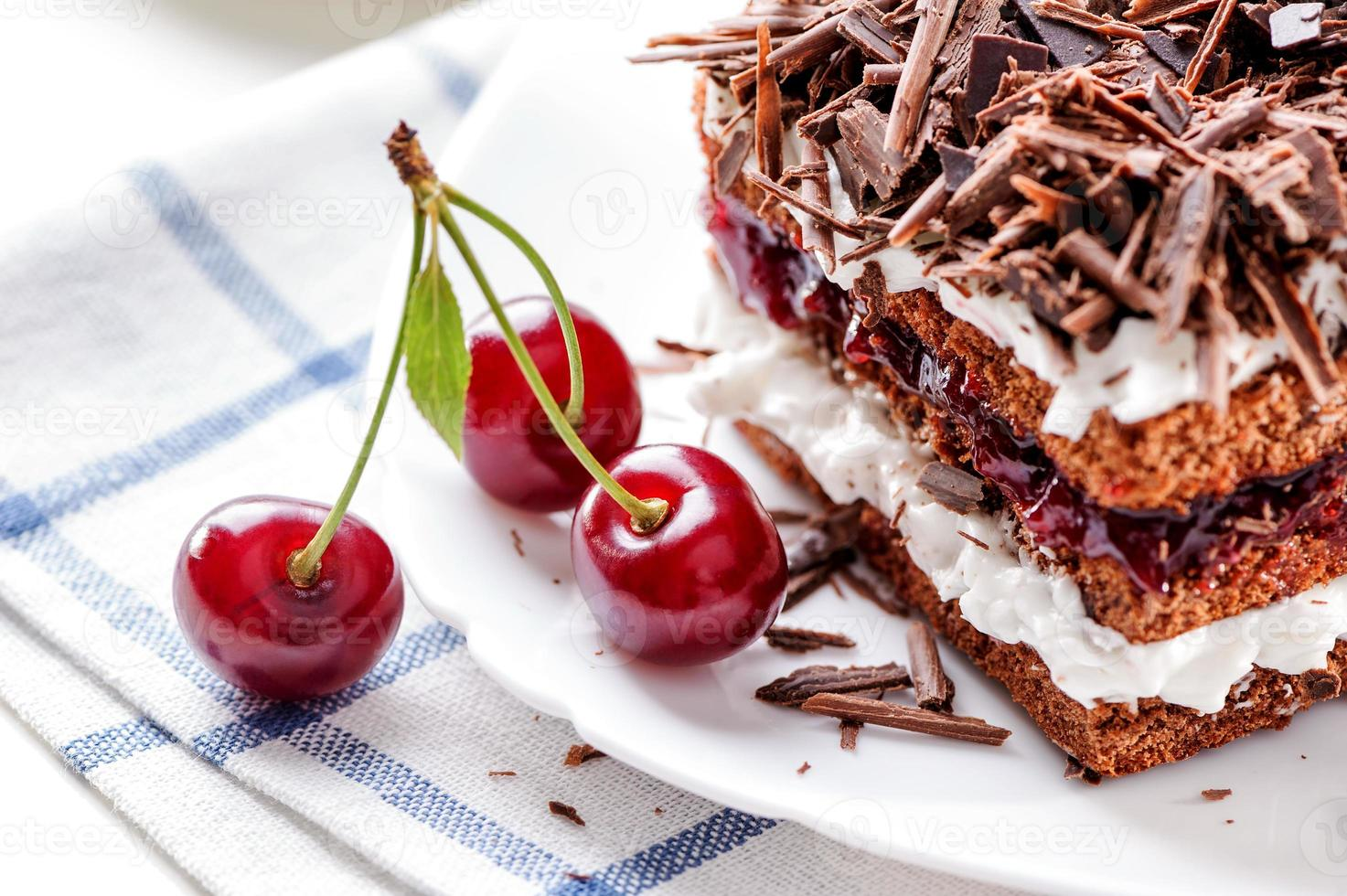 Black Forest cake piece with cherries berries photo
