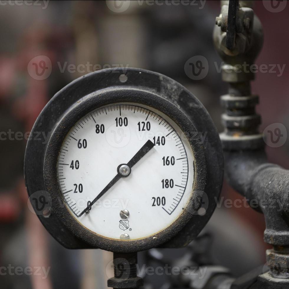 Closeup of Antique Steam Engine Pressure Gauge photo