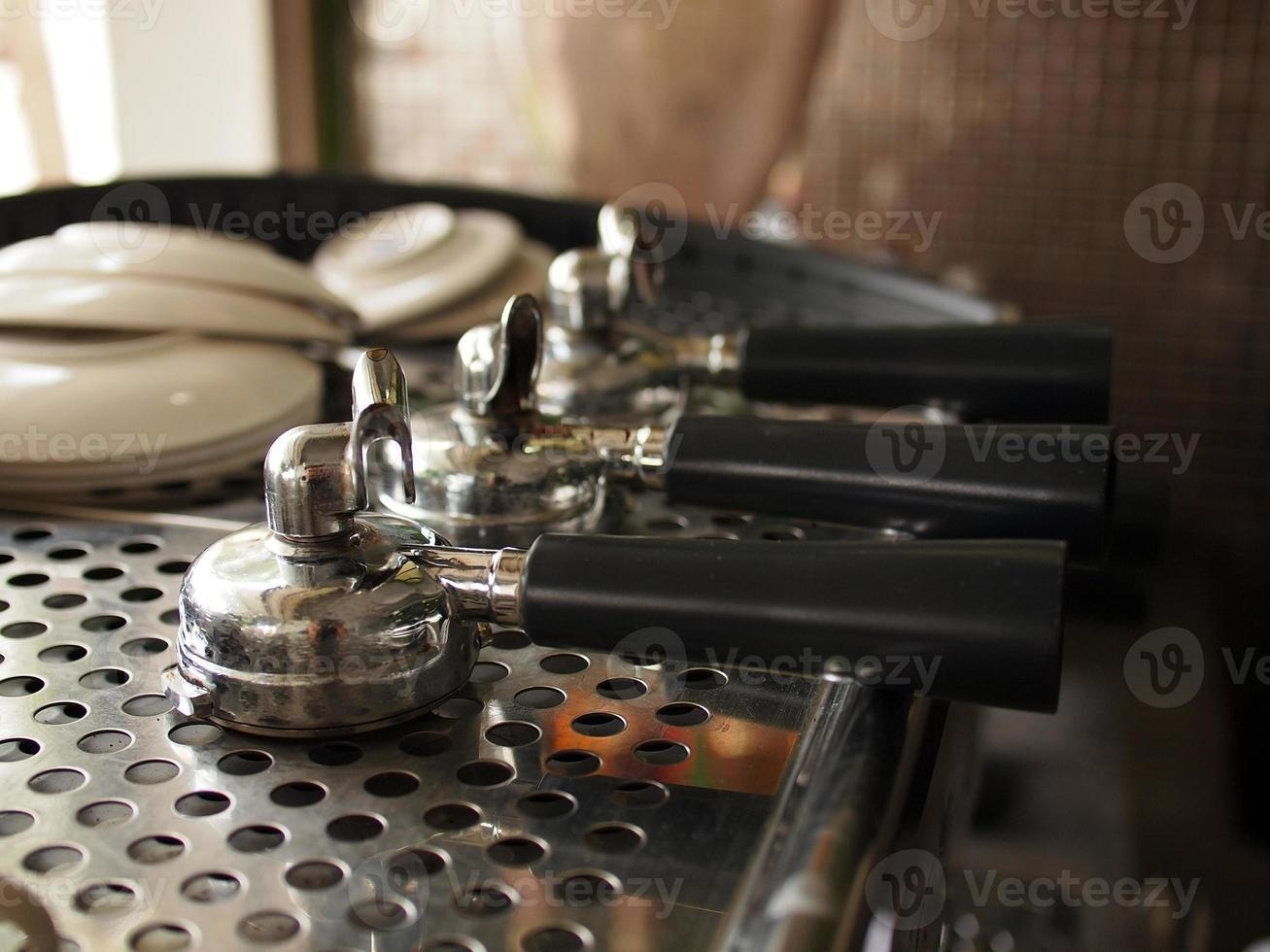 Three portafilters on espresso machine photo