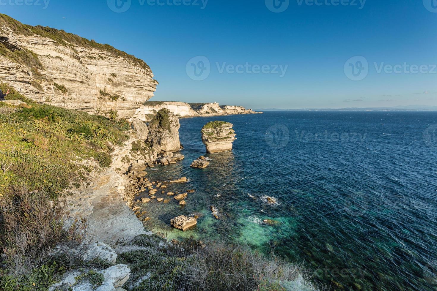 White cliffs, stacks and Mediterranean at Bonifacio in Corsica photo