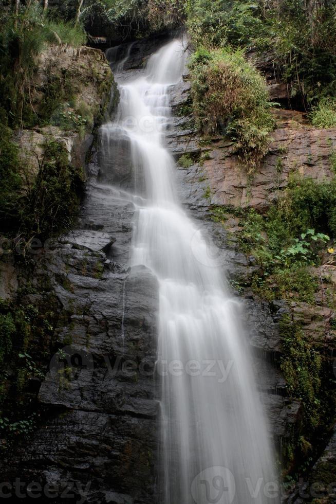 Deep forest waterfall at National Park Si-satchanalai Thailand photo