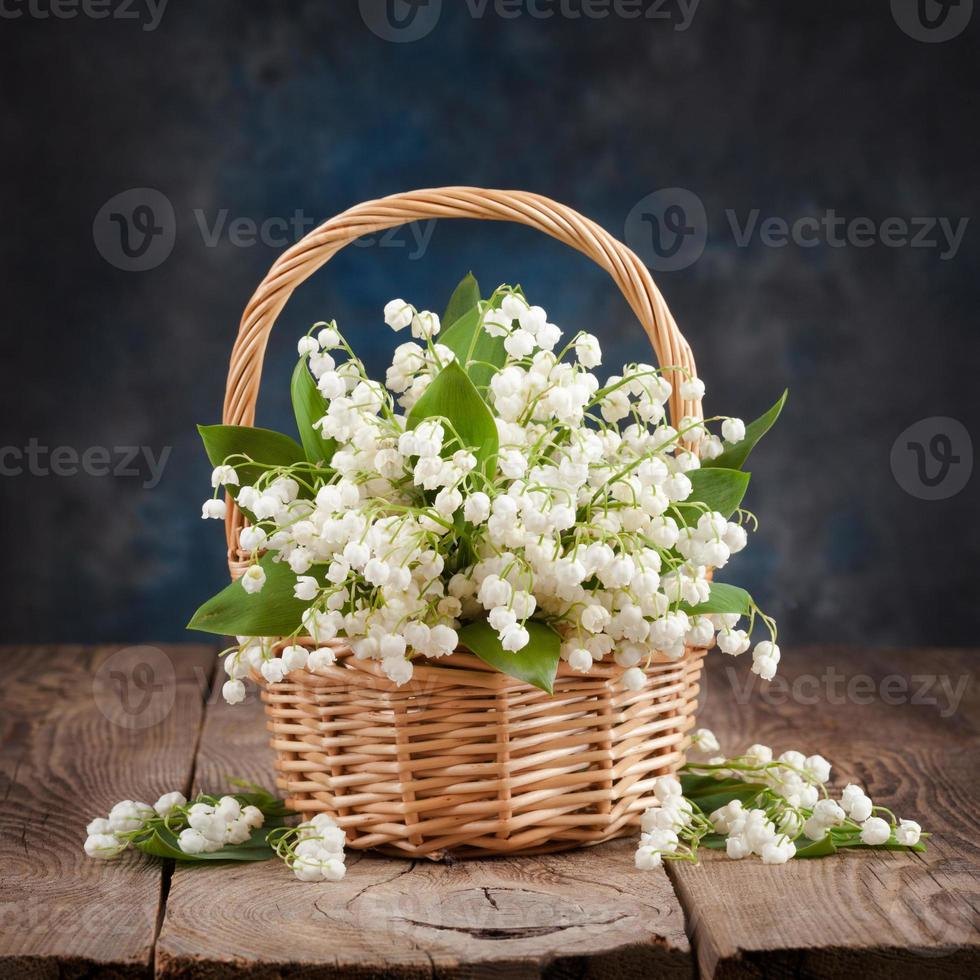 Bouquet of lilies of the valley on the table photo