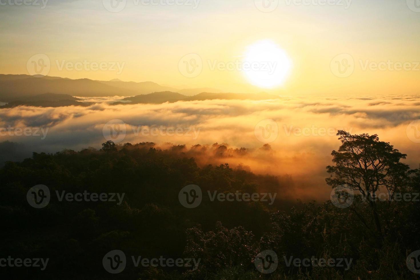 Sunrise over mountain and fog photo