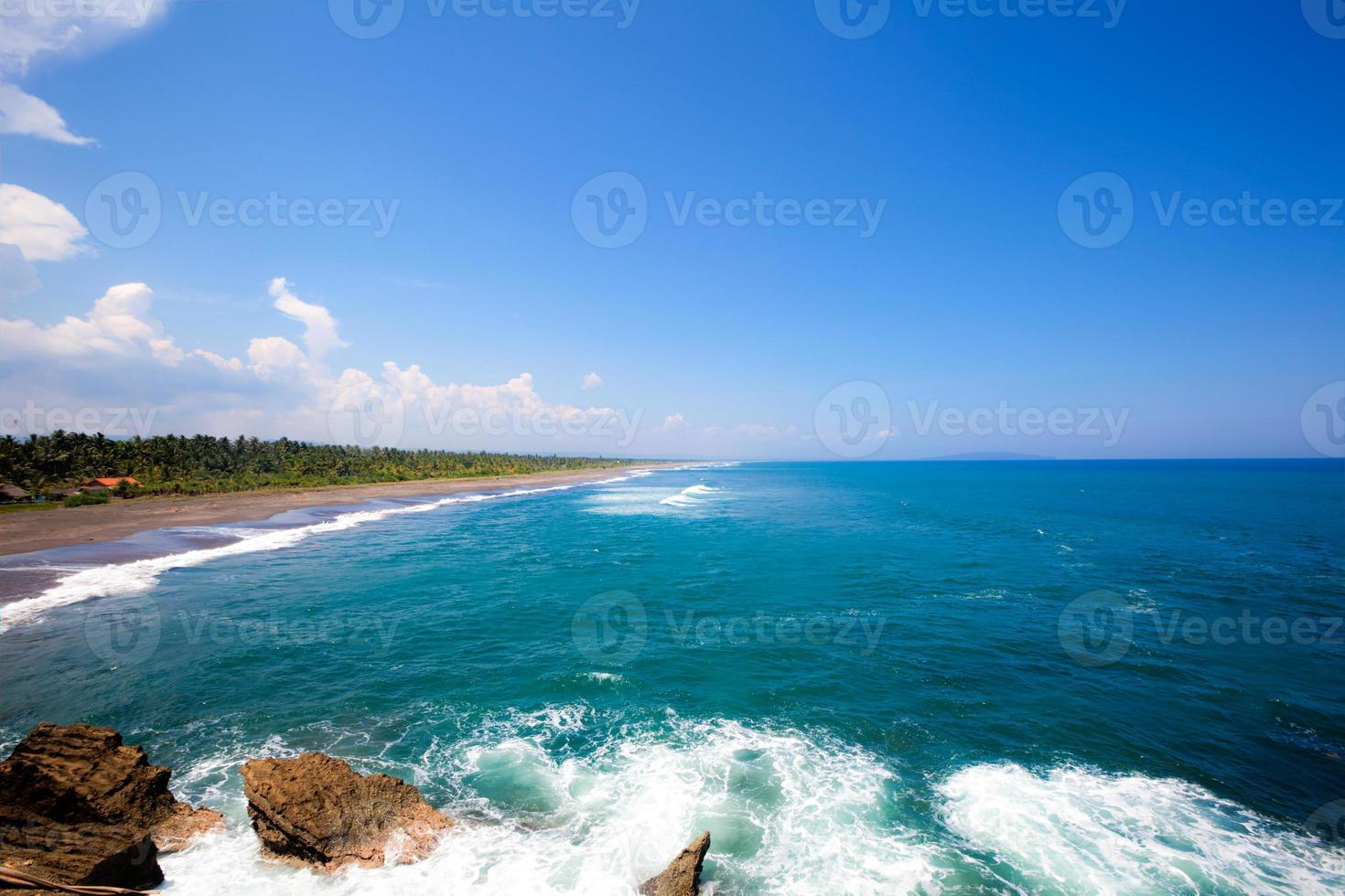 Beach coast ultra wide view with blue sky in Indonesia photo