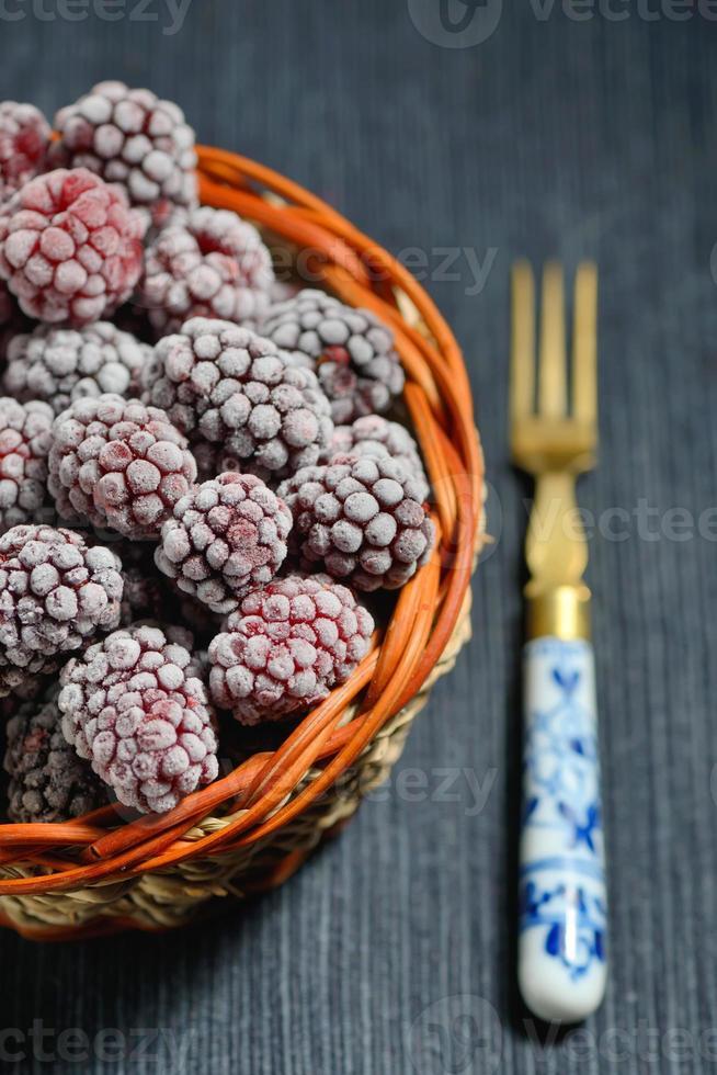 frozen blackberries isolated photo