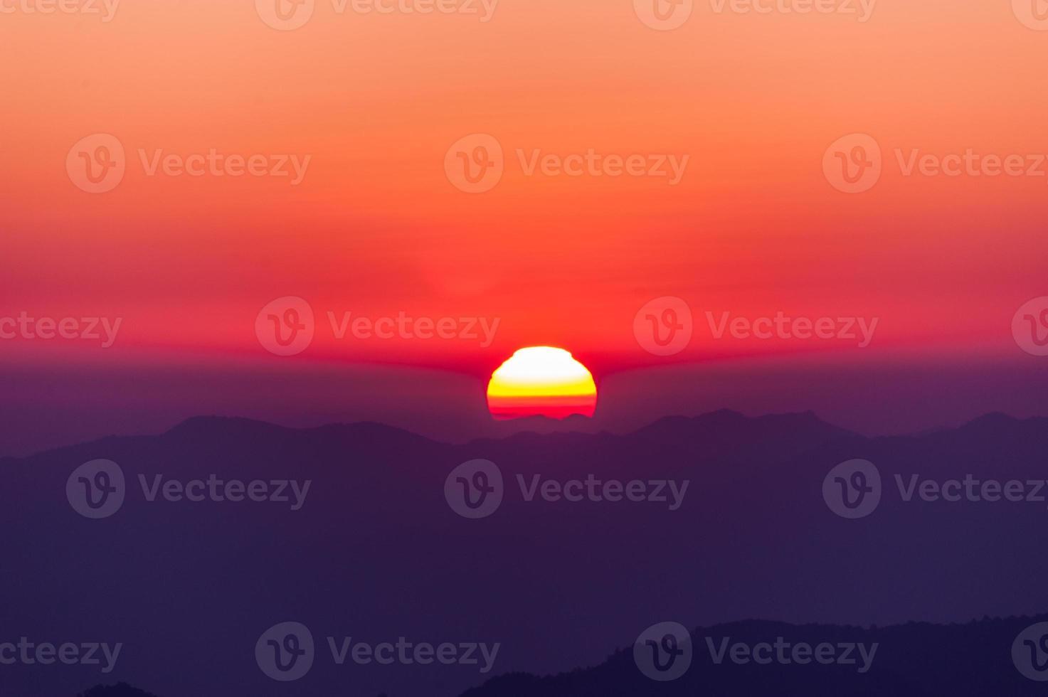 sunrise with mountains photo