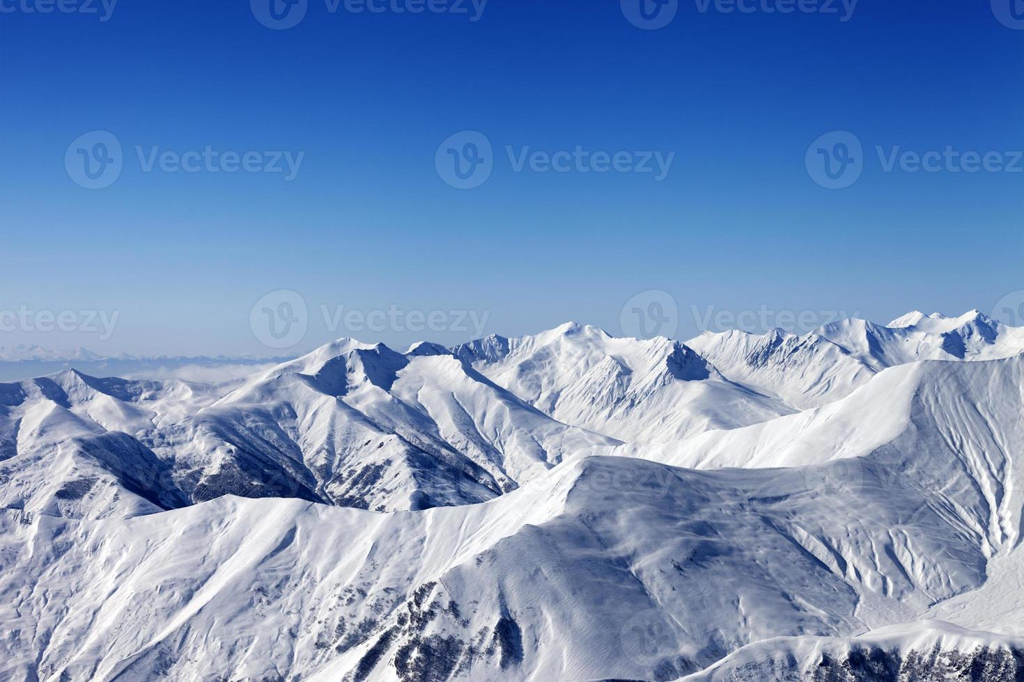 View on off-piste slope at nice sun day photo