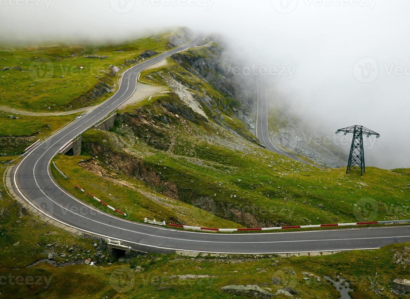 Mountain road with fog photo