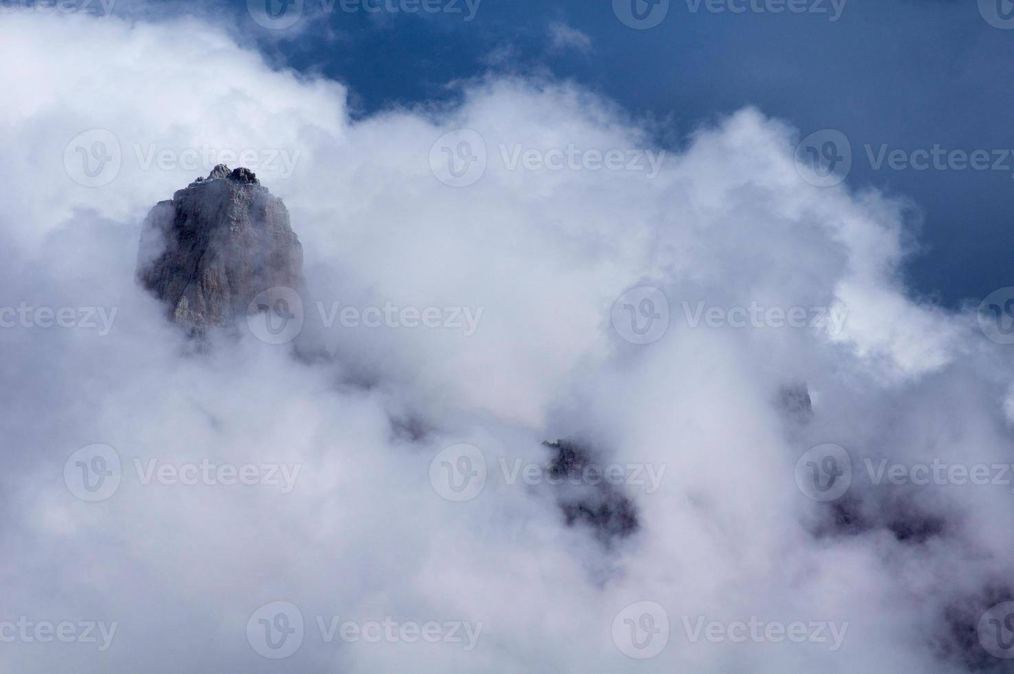 Amazing clouds in the mountains photo