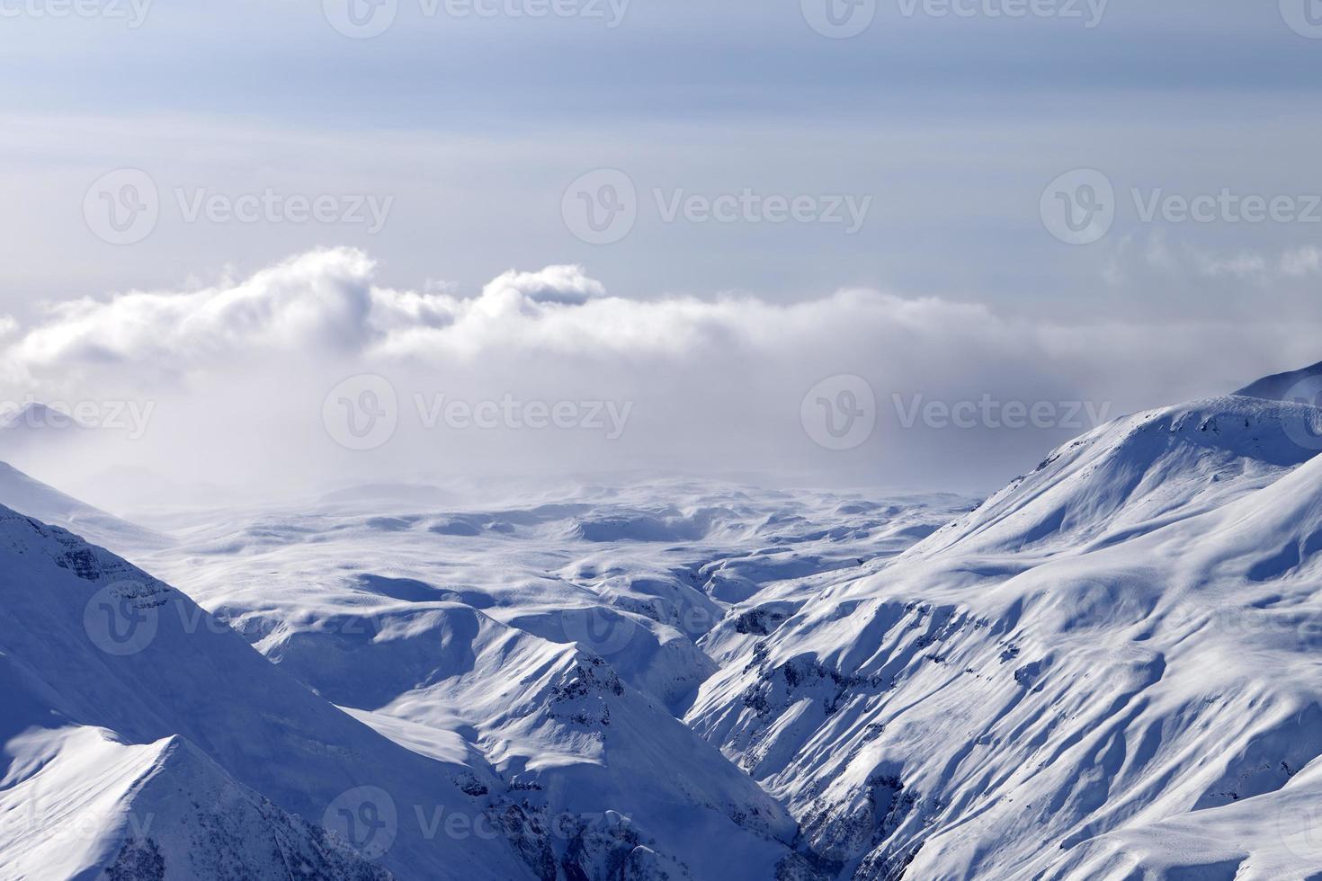 Snow plateau in fog photo