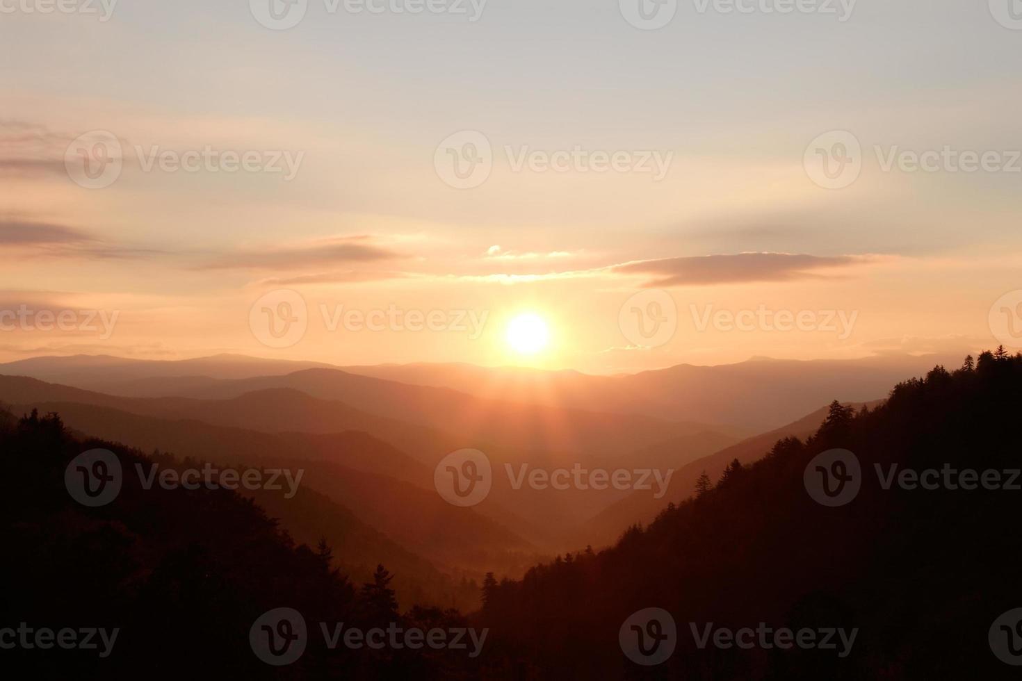 Sunshine over Mountain Peaks photo