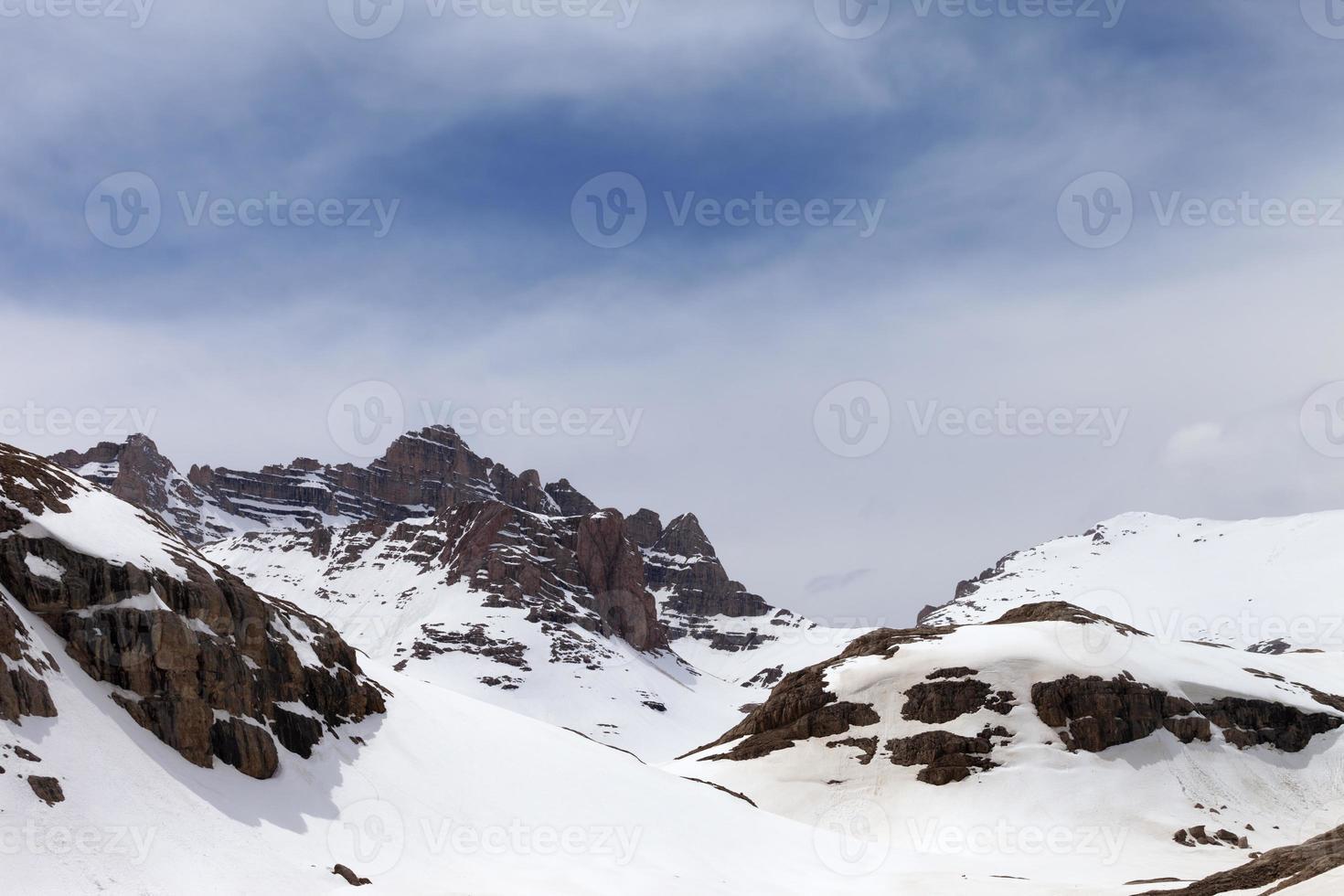 Snow mountains in fog photo