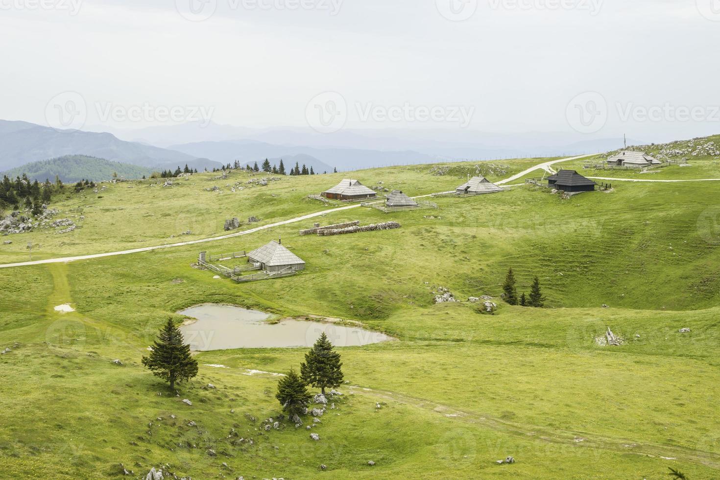 Traditional Slovenian mountain cottage village photo