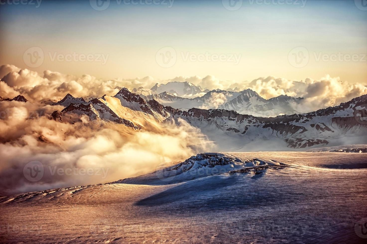 mountain ridge of Western Caucasus at sunset or sunrise photo