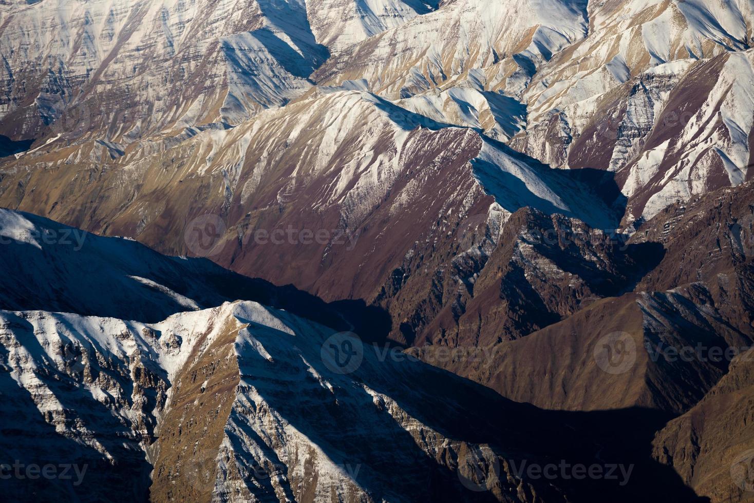 snow capped mountain range photo