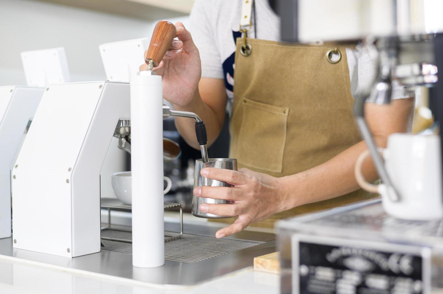 Barista making a cup of coffee  photo
