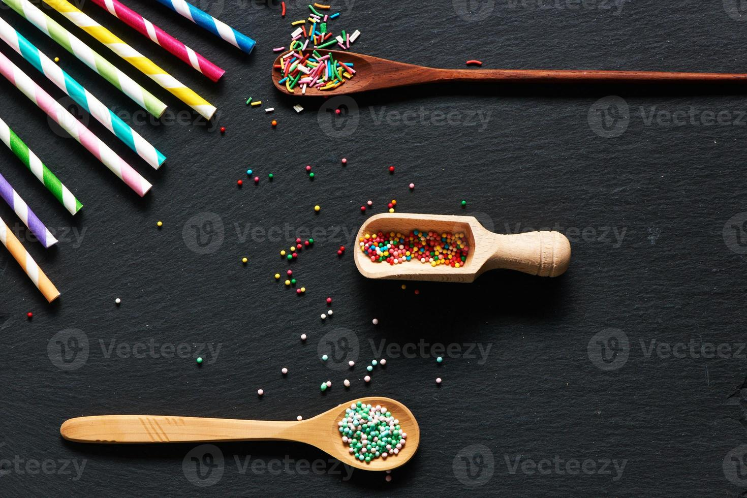 Drinking straws and sugar sprinkle dots photo