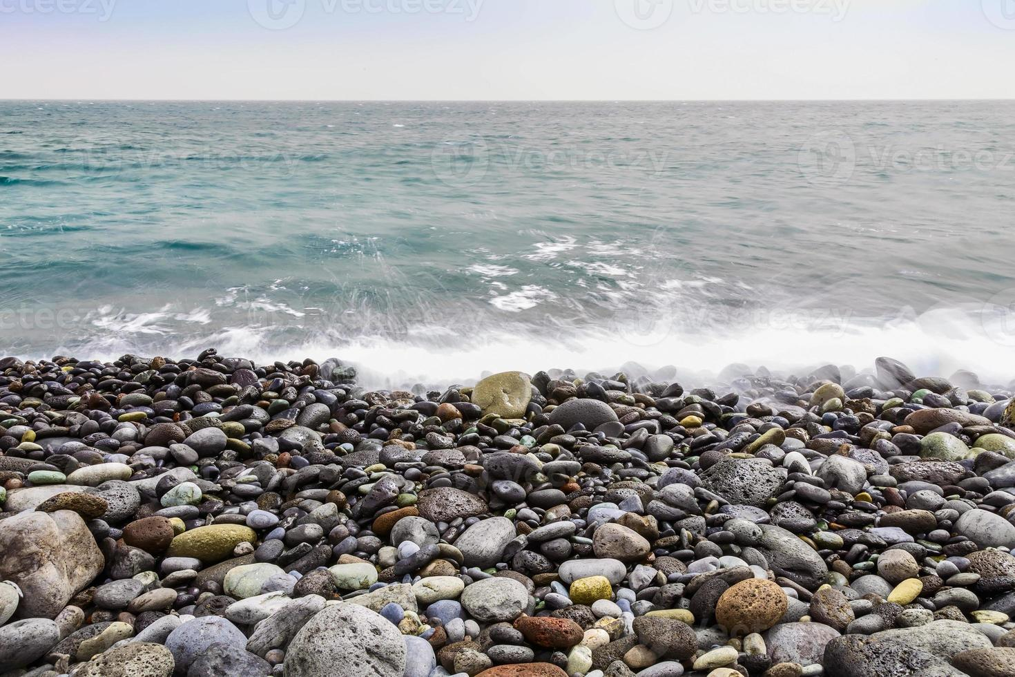 Stone Coast of Ocean with Waves photo