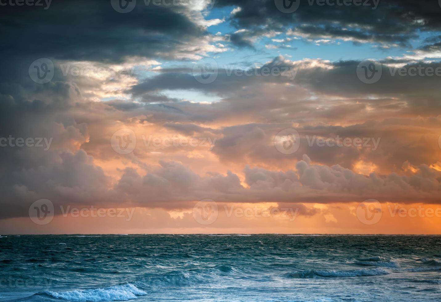 Dark colorful sunrise sky over Atlantic ocean photo