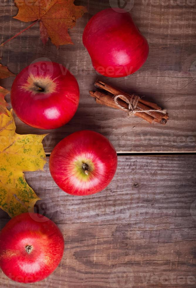Red apples and yellow leaves photo