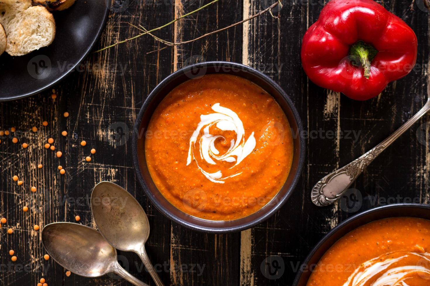 Pumpkin soup with heavy cream photo