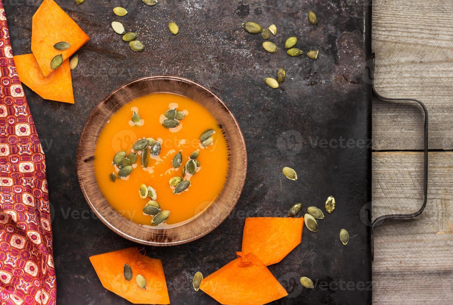 Fresh orange pumpkin soup in a bowl photo