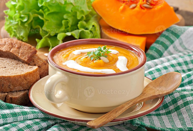 Delicious cream of pumpkin soup in a bowl photo