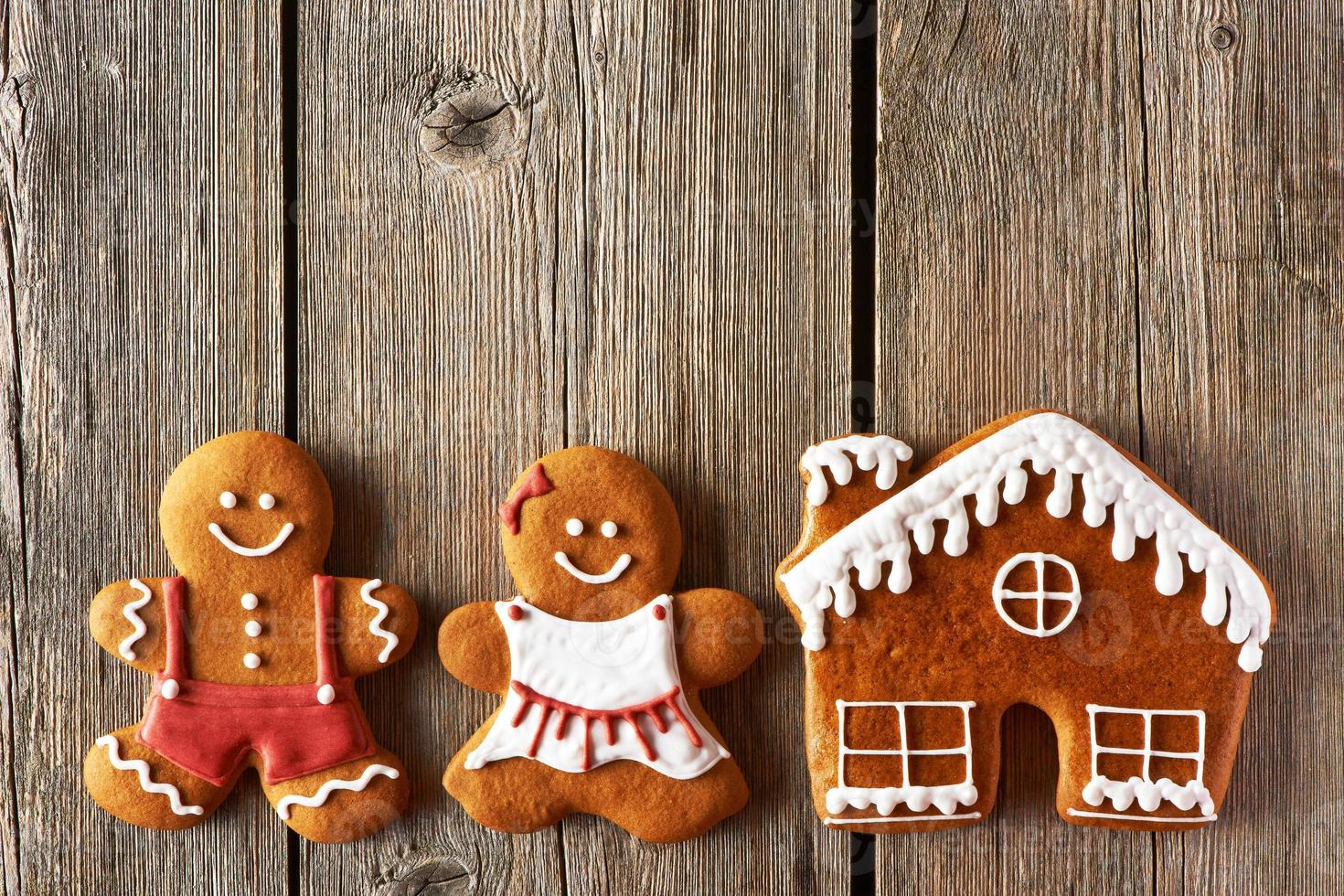 Christmas gingerbread couple and house cookies photo