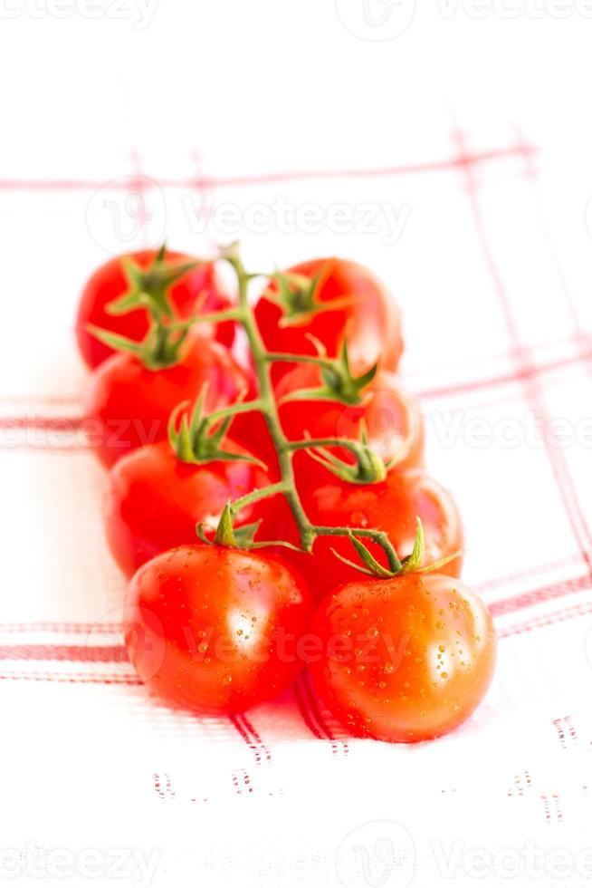 Wet juicy organic Cherry tomatoes photo