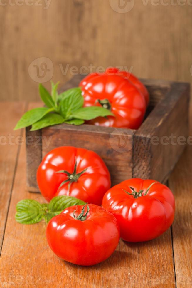 Tomatoes in wooden  box photo