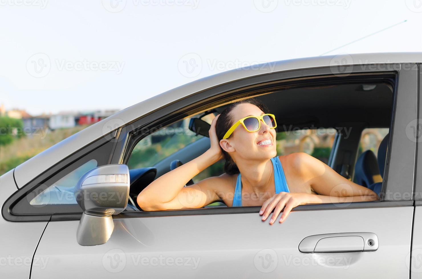coche mujer conductor feliz foto