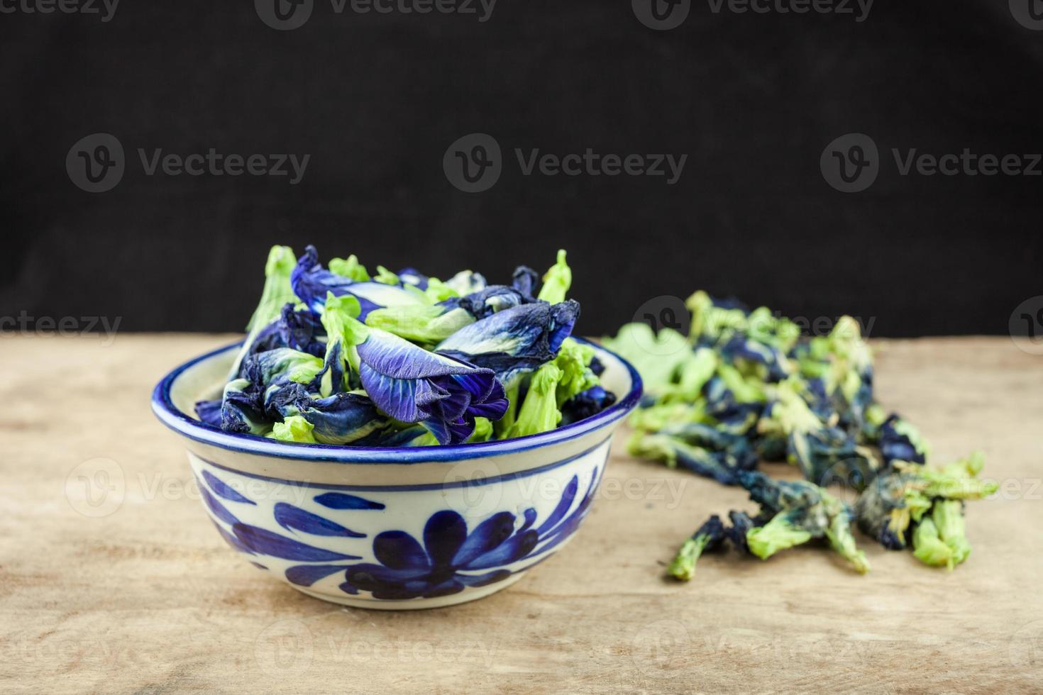 Fresh Butterfly pea flower or Clitoria ternatea on wooden plank photo