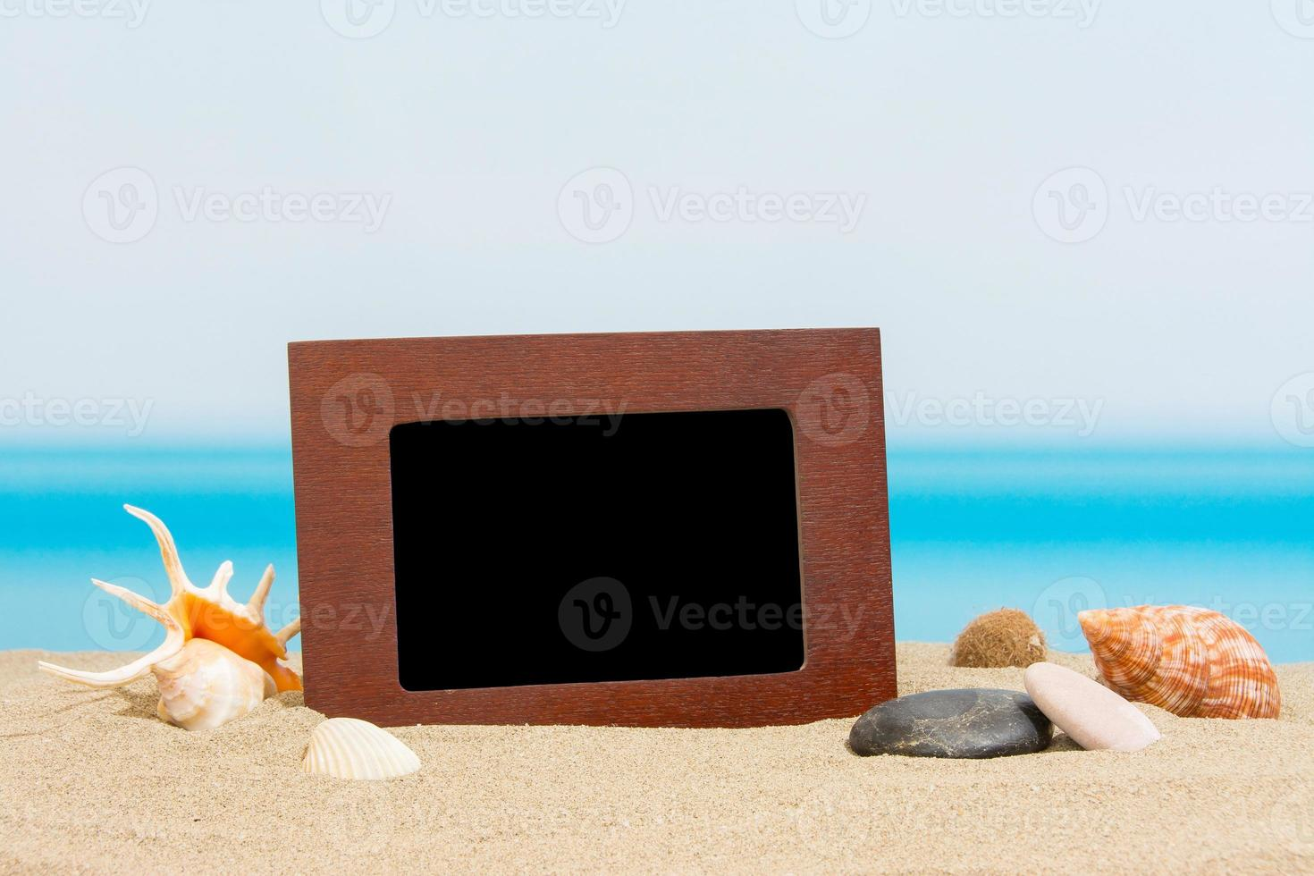 Pictures frame on the beach photo