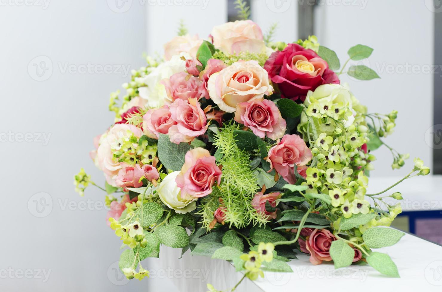Colorful flower bouquet on the white table photo