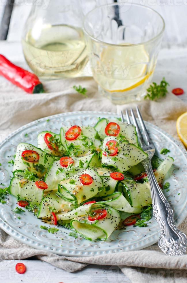 Salad with cucumber, pepper and poppy seeds photo
