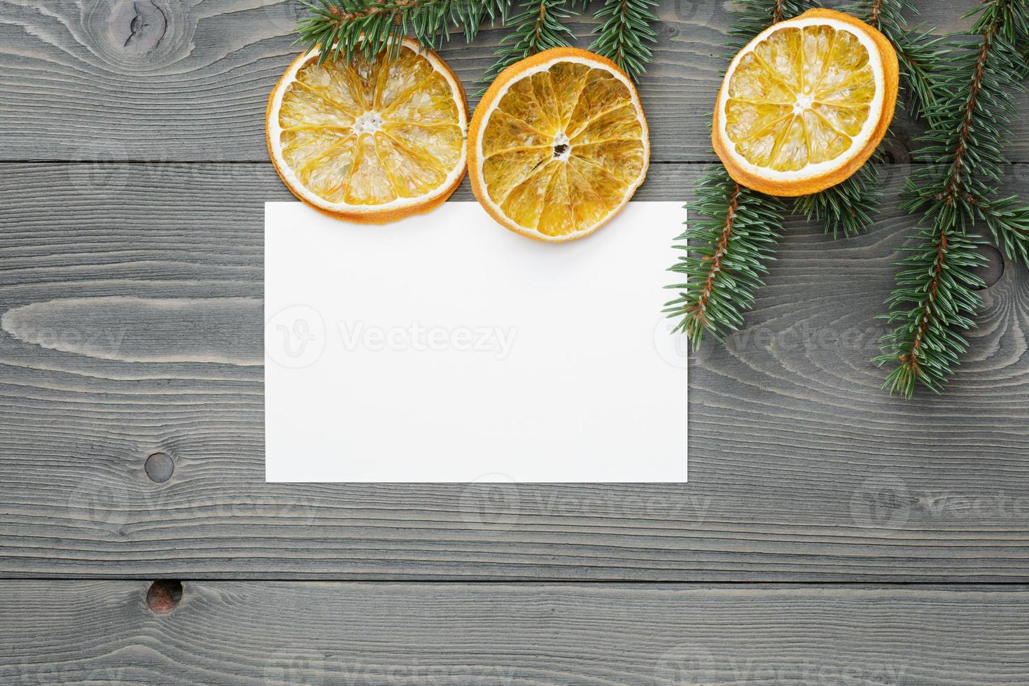 spruce twig with dried orange slices and greeting card photo
