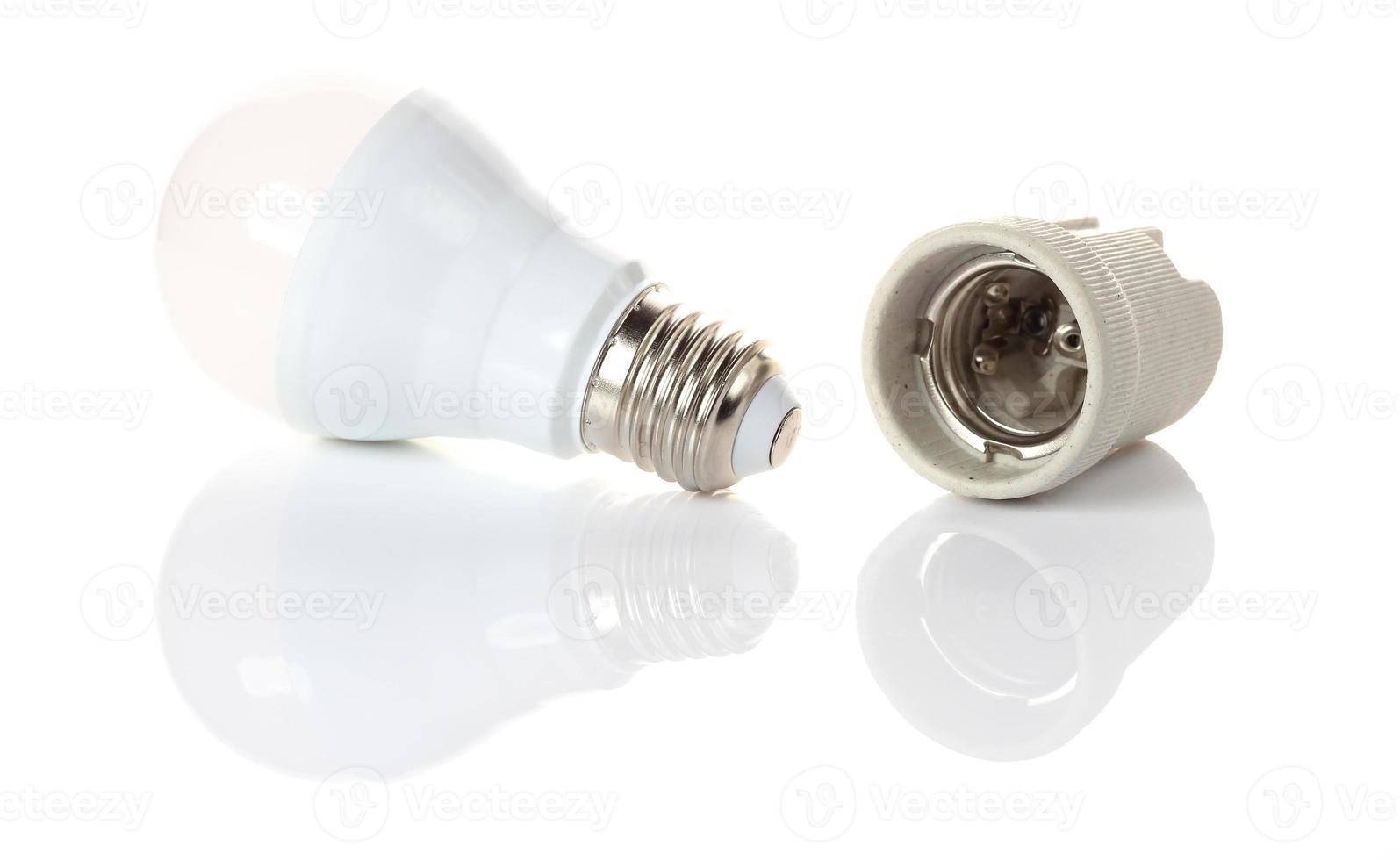 LED energy saving bulb on white photo