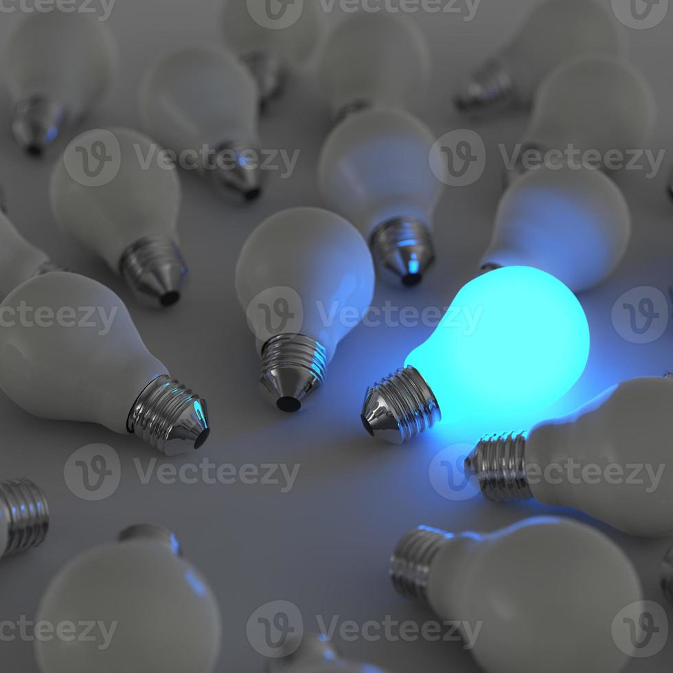 3d growing light bulb standing out from the unlit incandescent photo