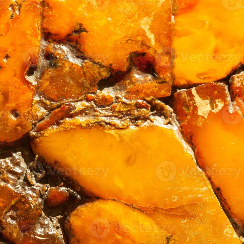 Closeup of golden amber as background or texture. Resin gem. photo