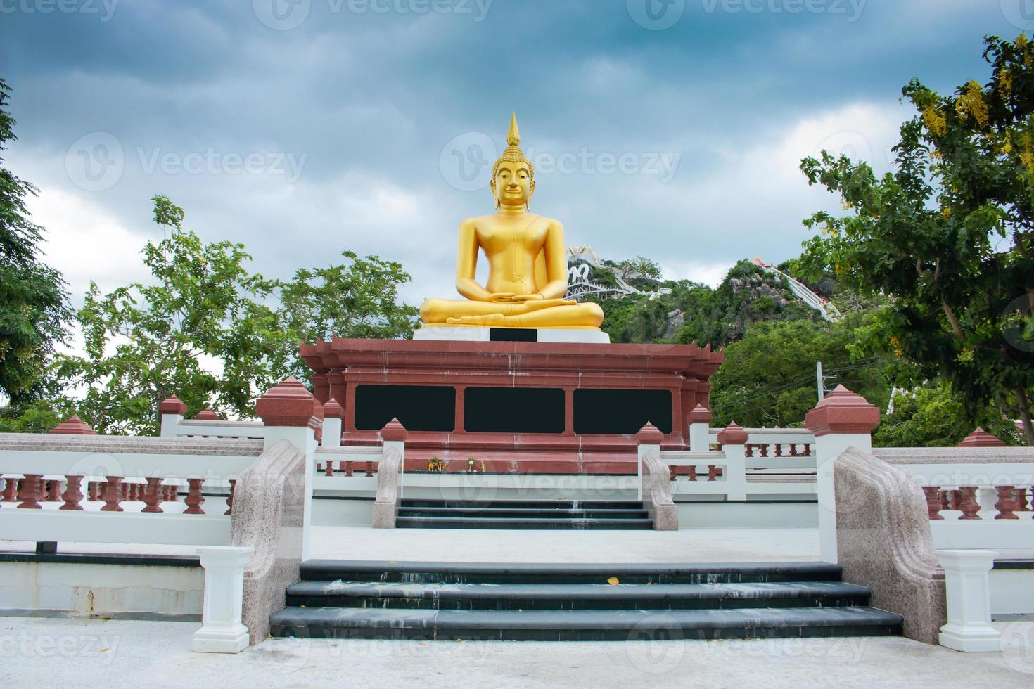 Buddha statues on blue sky before the rain front view photo