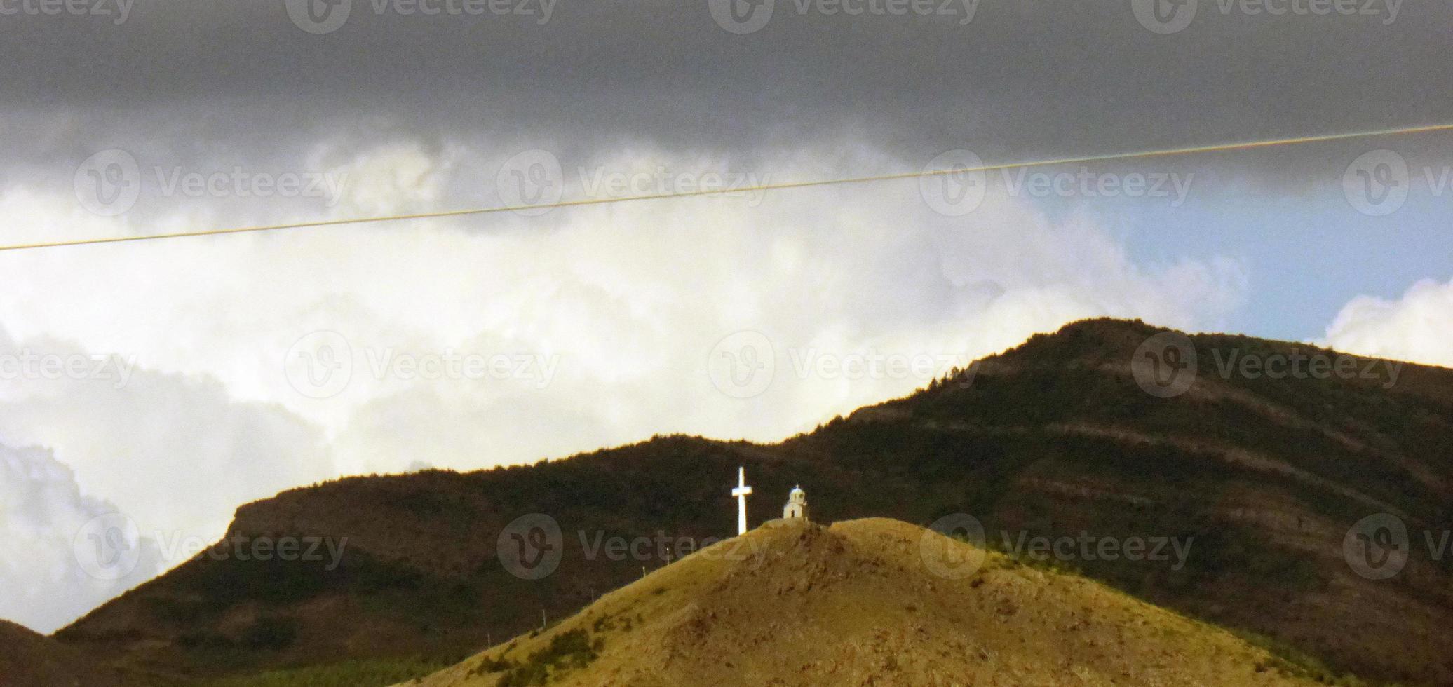Cross on mountain near Korche , Albania photo
