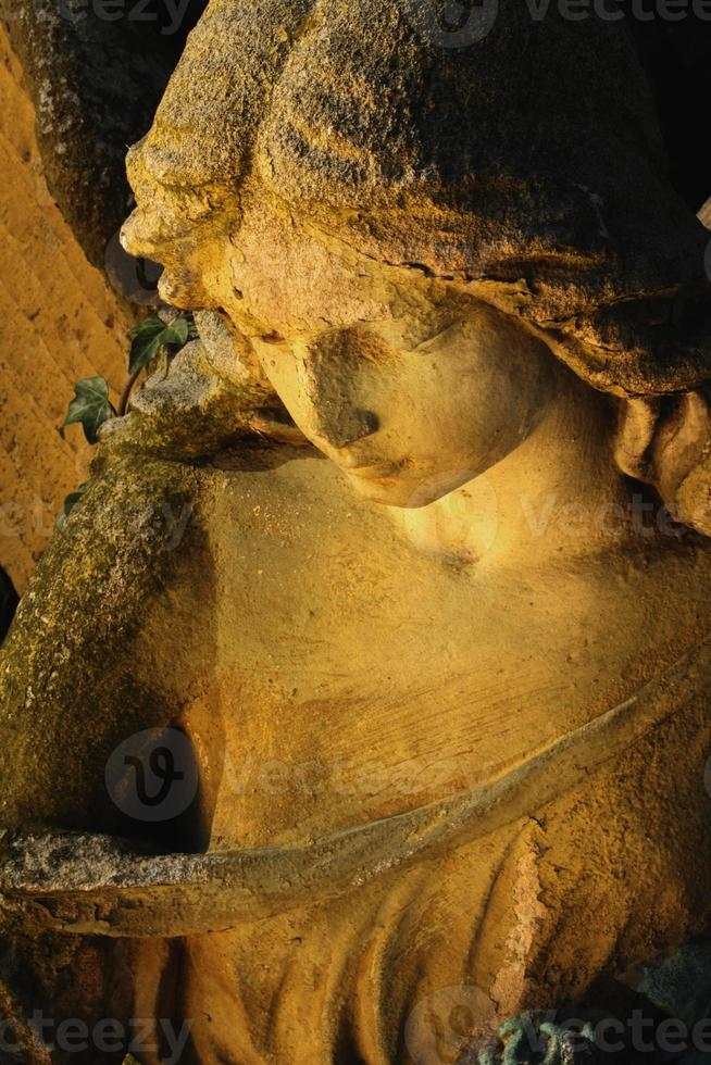 golden angel in the sunlight (antique statue) photo